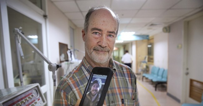 Father: American burned in Taiwan park fire fights for life
