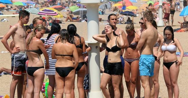 Western Europe sweats _ and enjoys _ unusual heat wave