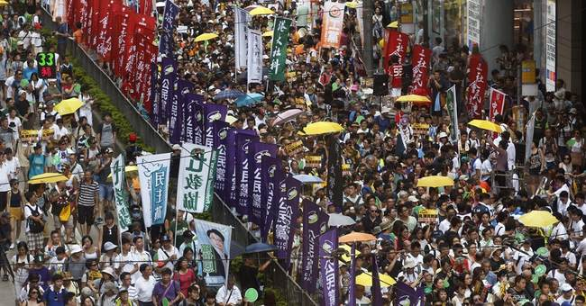 Turnout slim as thousands in Hong Kong rally for democracy
