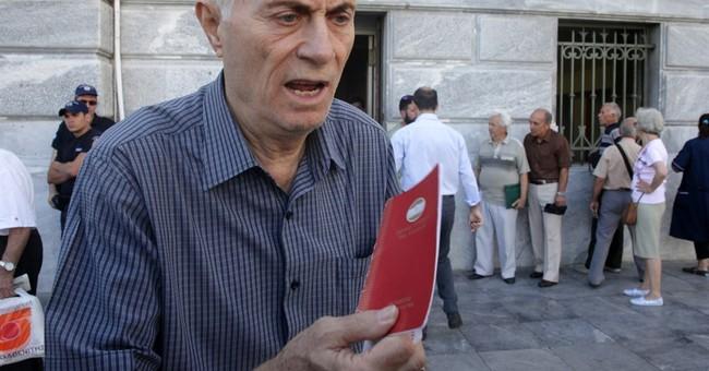 The Latest:  Moody's downgrades Greece to Caa3
