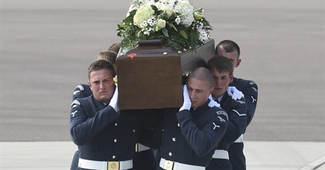 Solemn ceremony marks return of Tunisia attack victims to UK