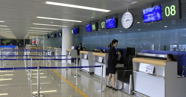 With great fanfare, Pyongyang opens new airport terminal