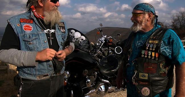 A biker named 'Stray Dog' postpones Granik's Ozarks exit