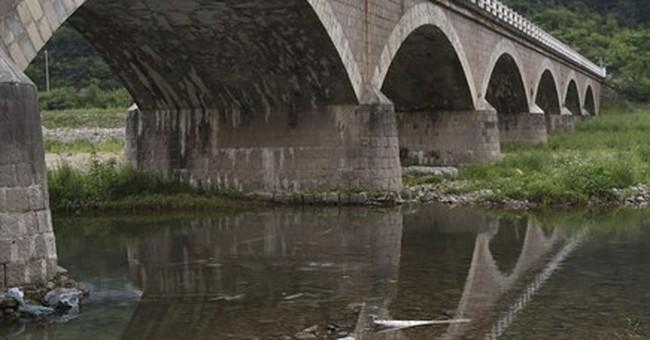 Bus falls off bridge, killing 10 South Koreans