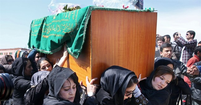 Afghan court cancels death sentences in mob killing of woman