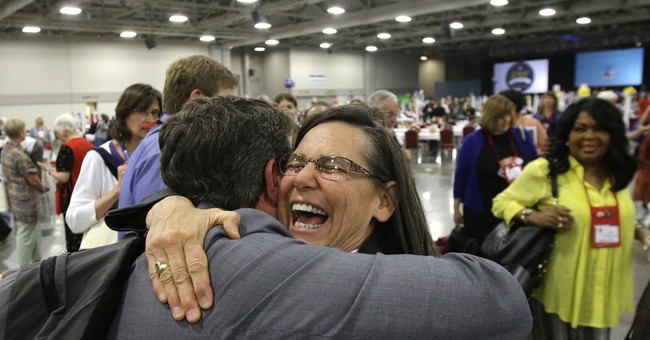 Episcopalians vote to allow gay marriage in churches