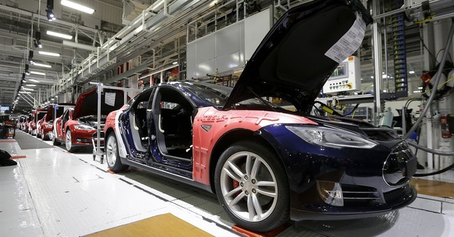 Tesla tops 11,000 vehicles delivered in second quarter