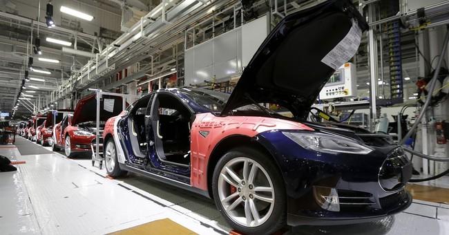 Tesla tops 11,000 vehicles delivered in second quarter