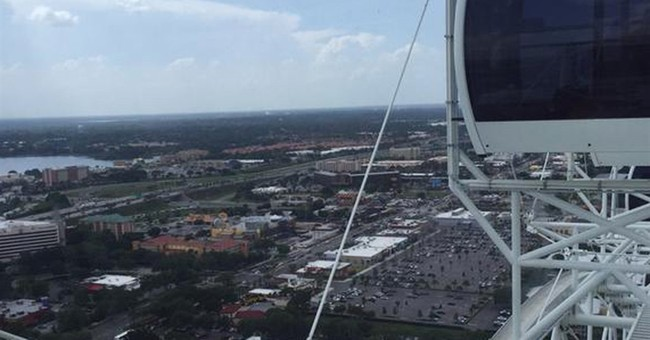 66 riders safely evacuated after 400-foot Ferris wheel stops