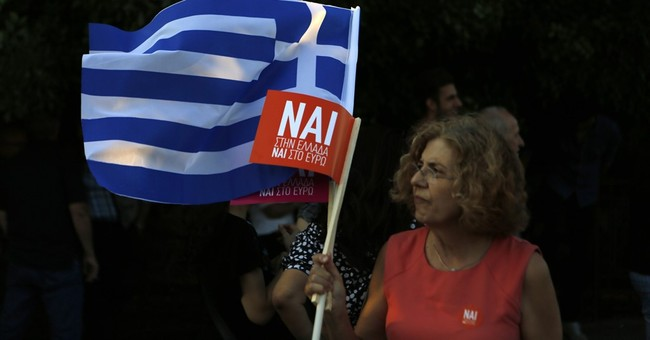 The Latest: Greek PM urges voters to ignore scaremongers
