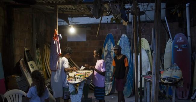 AP PHOTOS: Surfing takes Brazilian kids out of Rio slum