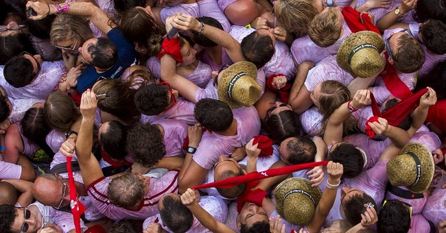 Running of the bulls festival starts; crowd doused in wine