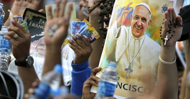 Pope puts family first at outdoor Mass in steamy Guayaquil