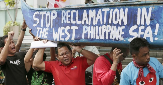 China to snub arbitration hearing on feud with Philippines