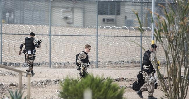 Arizona governor calls for probe of private prison unrest