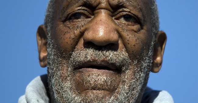 The Latest: Smithsonian stands by Cosby art exhibition