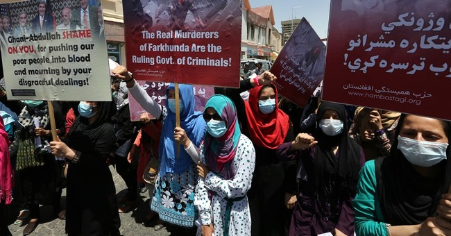 Afghans protest court ruling in mob killing of woman