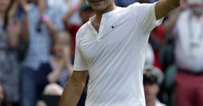 A win, then a hug: Serena Williams tops Venus at Wimbledon