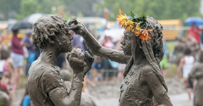 Rain makes annual Detroit-area Mud Day for kids even muddier