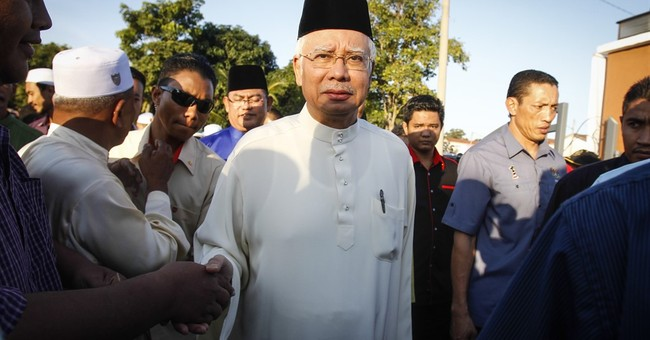 Malaysia freezes 6 bank accounts in probe linked to premier
