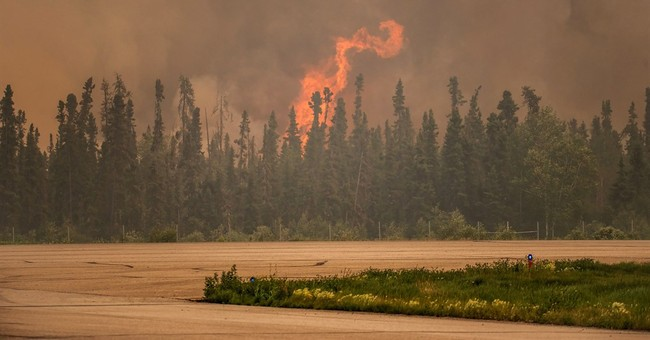 Some progress in quelling wildfires raging in Canada