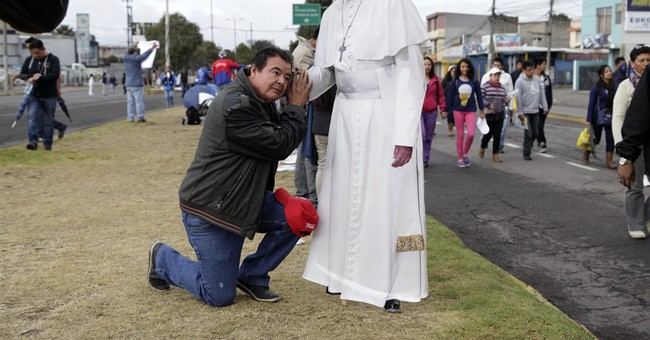 The Latest: Pope visits Jesuit church, then calls it a day