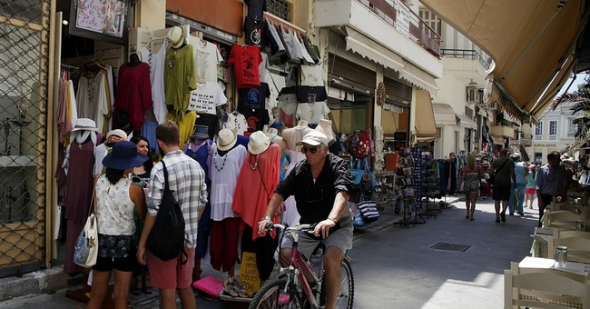 Largely shielded from crisis, tourists still enjoying Greece