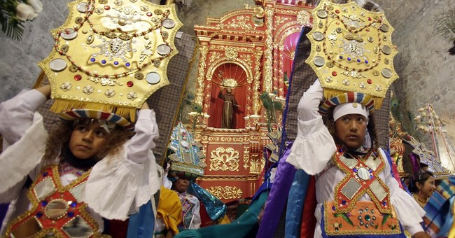 AP PHOTOS: Pope encountering rich indigenous traditions