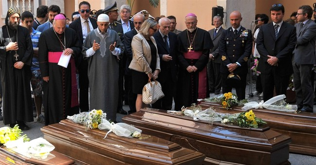 13 coffins: Italy buries 1st bodies from migrant shipwreck