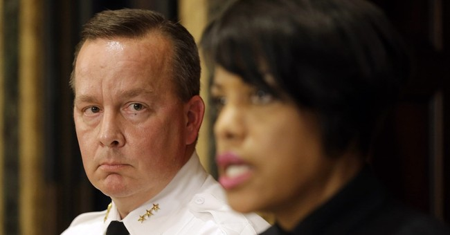 Baltimore mayor fires police commissioner amid homicide rise