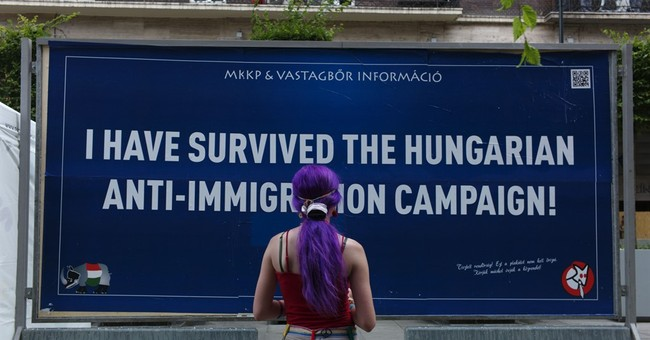 Satirical billboards tackle Hungary's anti-immigrant drive