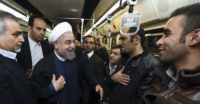 Surprised Iran subway riders brush shoulders with president