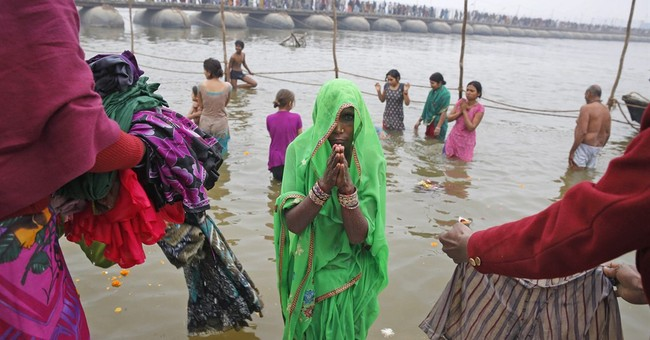 Image of Asia: A holy dip on a cold day in northern India