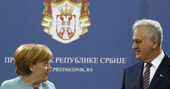 Germany's Merkel arrives in Bosnia to back economic reform