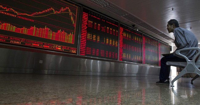 Wave of Chinese firms halt stock trading to avoid turmoil