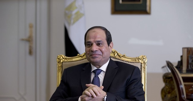 Egypt president signs election law, paving way for vote date