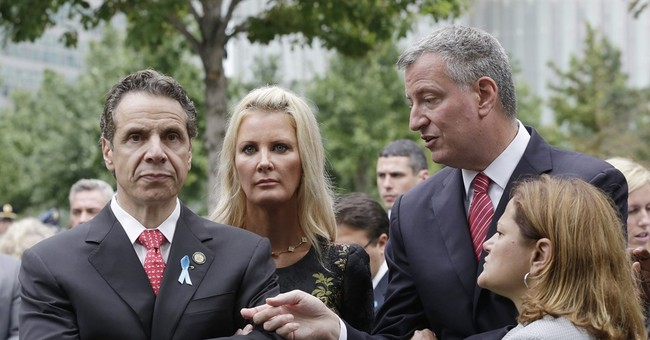 De Blasio, after hit from Cuomo, does not back down