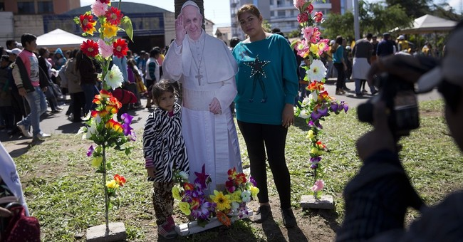 The Latest: Pope caps off his day with visit to ill cardinal