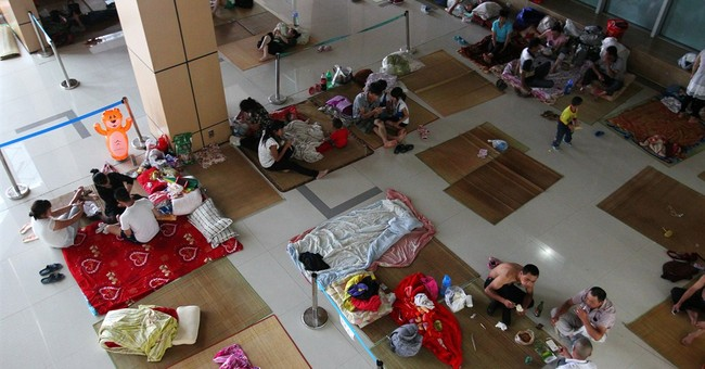China evacuates hundreds of thousands ahead of typhoon