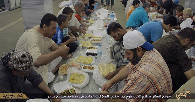 IS offers a mix of brutality, charity during Ramadan