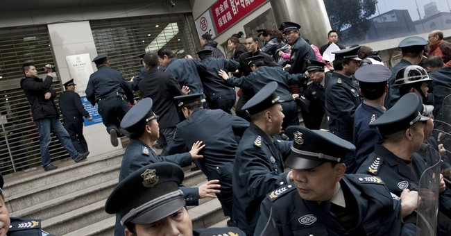 China's underground banks spread pain as defaults rise