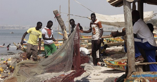 In Senegal, some fishermen resist lure of Europe migration