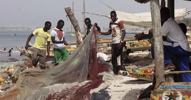In Senegal, some fishermen resist lure of Europe migration