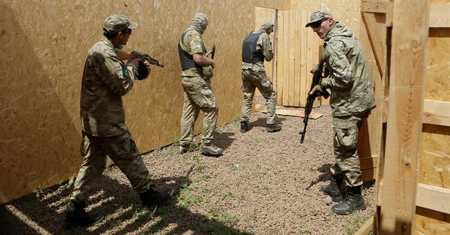 Ukraine's self-defense units look for the enemy within