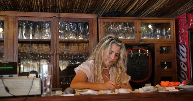 Greek tourist hotspots face big bailout tax hikes