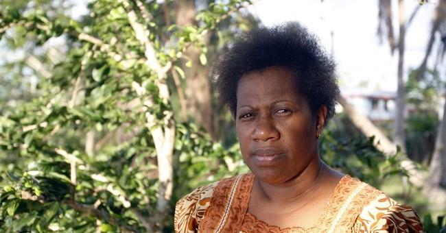 Wary of climate change, Vanuatu villagers seek higher ground