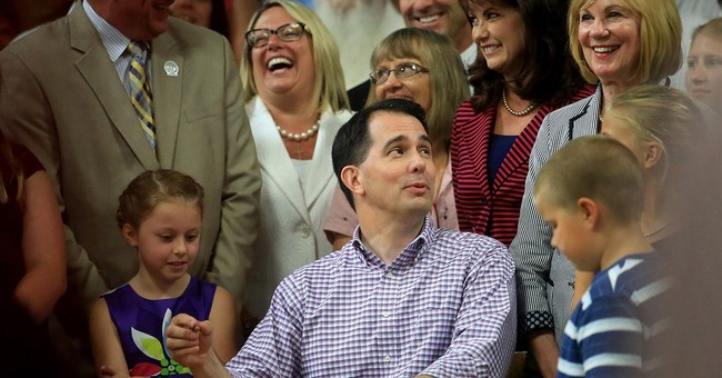 Wisconsin Gov. Walker signs state budget with changes