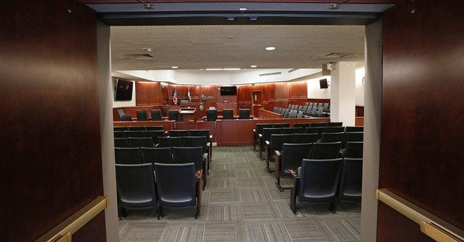 A look at insanity law at heart of theater shooting trial