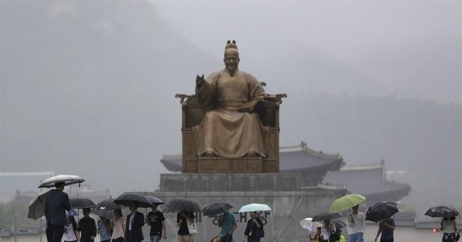 Image of Asia: A walk in the rain in Gwanghwamun Square