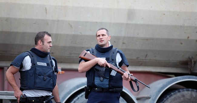 Paris police: 18 freed, gunmen at large after store robbery